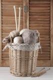 Knitting set in basket Royalty Free Stock Photos