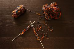 Knitting from skein of yarn on wooden background stock photography
