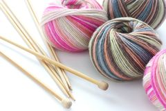 Knitting sock yarn balls with noodles Royalty Free Stock Photo