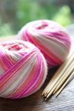 Knitting sock yarn balls with noodles Stock Photos