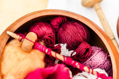 Knitting. Some traditional sewing and knitting tools in a medieval fair Royalty Free Stock Photography