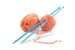 Knitting spokes with ball of wool isolated. Knitting spokes with ball of wool on white background stock image
