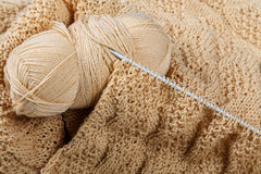 Knitting spokes with ball of wool on tabl Royalty Free Stock Image