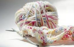 Knitting on the spokes Stock Photo