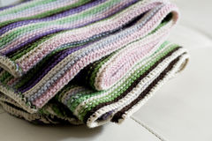 Knitting striped rug with white,  green and pink stripes Stock Image