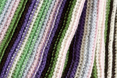 Knitting striped rug with white, green and pink stripes Royalty Free Stock Image