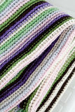 Knitting striped rug with white, purple, green stripes Royalty Free Stock Photos