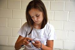 Knitting teenager girl Royalty Free Stock Photography