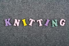 knitting Textura hecha punto de la tela Palabra compuesta de letras del alfabeto de ABC Foto de archivo libre de regalías