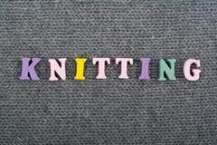 knitting Textura hecha punto de la tela Palabra compuesta de letras del alfabeto de ABC Imagenes de archivo