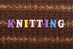 knitting Textura hecha punto de la tela Palabra compuesta de letras del alfabeto de ABC Imagen de archivo libre de regalías
