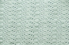 Knitting. Texture with a beautiful pattern from soft green threads stock image