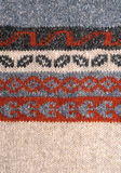 Knitting texture with ornament Royalty Free Stock Photo