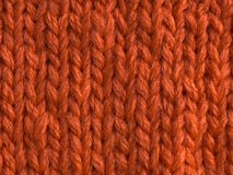 Knitting textured. Knitting of a cloth by orange thread Stock Photography