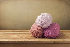 Knitting threads on wooden table Stock Photography