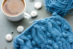Knitting a turquoise pattern on the circular needles Royalty Free Stock Photos