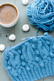 Knitting a turquoise pattern on the circular needles Stock Images