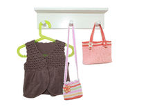 Knitting vest and handbags Stock Photos