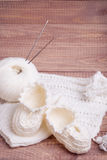 Knitting of white thread and balls Royalty Free Stock Image