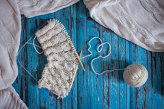Knitting with white woolen thread, knitting with braids Royalty Free Stock Photo