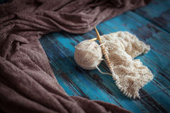 Knitting with white woolen thread, knitting with braids Royalty Free Stock Image