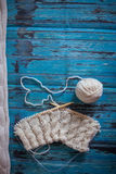 Knitting with white woolen thread, knitting with braids Stock Photography