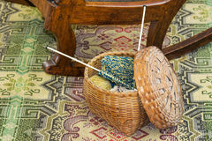 Knitting in Wicker Basket on Floor Stock Image