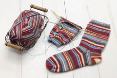 Knitting winter warm socks, yarn ball and knitting needles Stock Photo