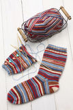 Knitting winter warm socks, yarn ball and knitting needles Stock Photos