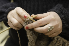 Knitting. Woman's hands knitting a sweater Royalty Free Stock Photography