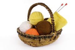 Knitting wool. Assorted yarn in basket, isolated on white stock photo