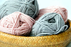 Knitting wool in basket. Closeup of pink and gray knitting wool royalty free stock images