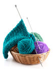 Knitting wool and a few balls in the basket for needlework on a Royalty Free Stock Photos