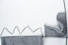 Knitting wool and knitting needles, sweaters , hendmade. Knitted sweaters with knitting needles and wool, hendmade Stock Photos