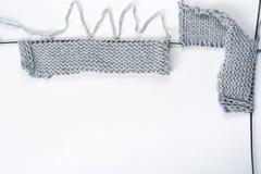 Knitting wool and knitting needles, sweaters , hendmade. Knitted sweaters with knitting needles and wool, hendmade Royalty Free Stock Photo