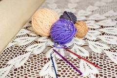 Knitting wool and knitting needles, knitting equipment royalty free stock images