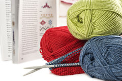 Knitting wool and pens with pattern book Stock Image