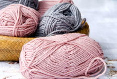Knitting Wool. Pink and gray knitting wool closeup stock image