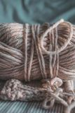 Knitting wool yarn with needles. Pastel color balls of yarn. stock photography
