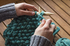 Knitting a woolen scarf Royalty Free Stock Images