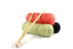 Knitting Yarn. Three bundles of yarn with knitting needles royalty free stock photo
