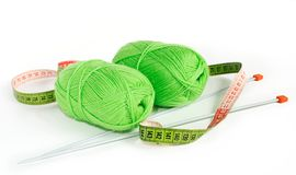 Knitting yarn. Two green knitting yarn with spokes and a centimetric tape Royalty Free Stock Image