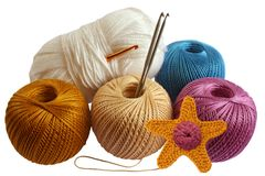 Knitting and yarn. It is knitted starfish and yarn balls isolated on white background Royalty Free Stock Photos