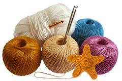 Knitting and yarn. This are knitted starfish and yarn balls Royalty Free Stock Photography