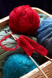 Knitting yarn balls and needles in basket Stock Photography