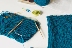 Knitting, yarn, knitting needles on the table. texture of knitte Stock Photography