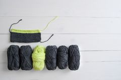 Knitting yarn with knitting pattern and ruler on white wooden background. The concept of Hobbies, crafts, the beginning of a new k. Nitting project stock photography