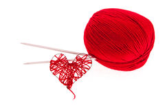 Knitting yarn with needles and a heart Stock Images