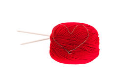 Knitting yarn with needles and a heart Royalty Free Stock Image