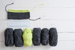 Knitting yarn with knitting pattern and ruler on white wooden background. The concept of Hobbies, crafts, the beginning of a new k. Nitting project stock image